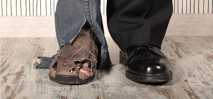 Man wearing one new shoe and one old shoe