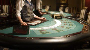 Dealer spreading cards on a blackjack table
