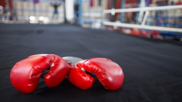 Red boxing gloves in a ring