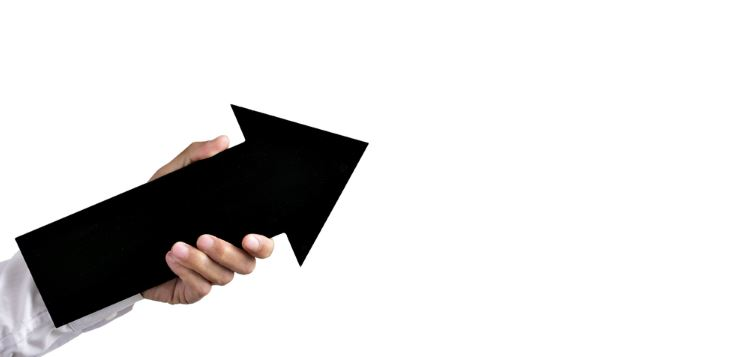 Man holding a black up arrow