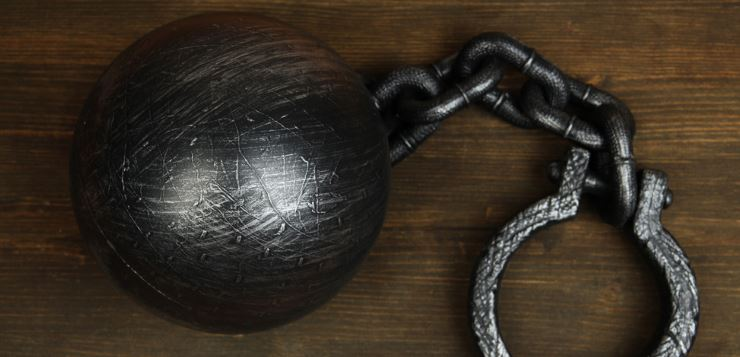 Ball and chain on a wood surface