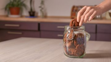 Hand in cookie jar